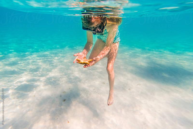 Little Girl Swimming Snorkeling With Starfish Underwater at Caribbean Resort White Sand Beach by JP Danko for Stocksy United