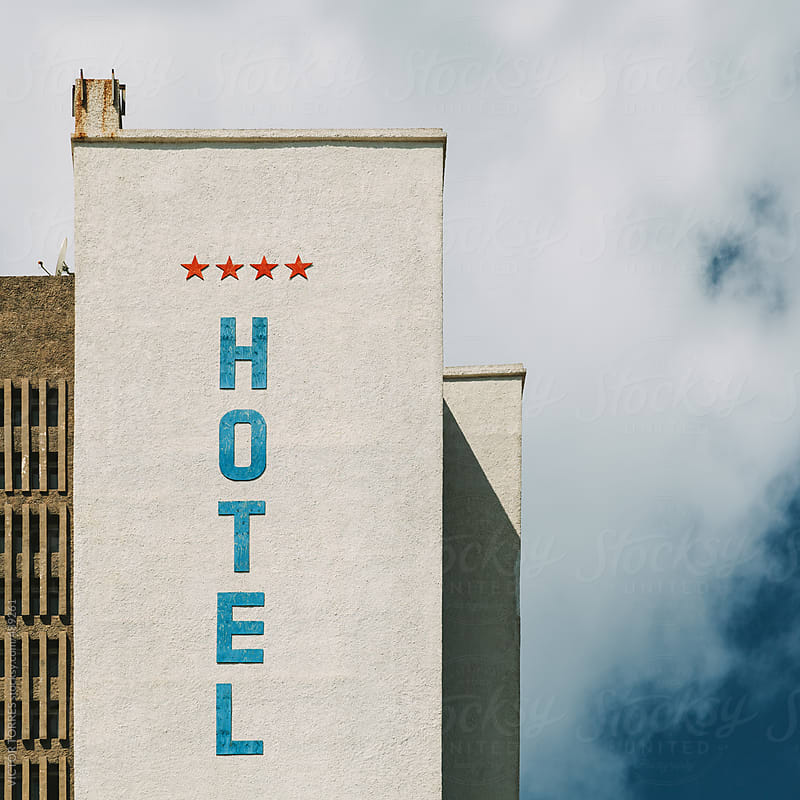 Hotel Sign on a White Facade by VICTOR TORRES for Stocksy United