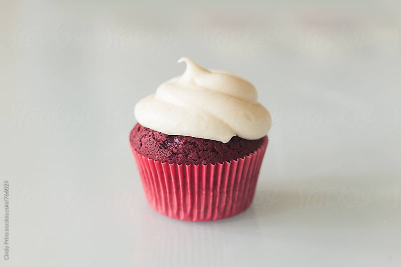 A single red velvet cupcake by Cindy Prins for Stocksy United