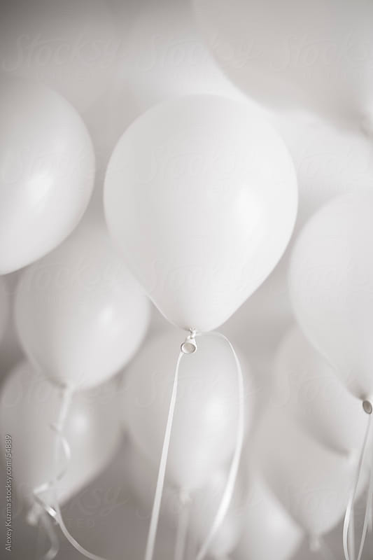 white  pastel balloons by Alexey Kuzma for Stocksy United