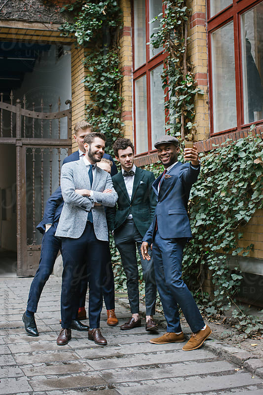 Five Young Men in Suits Taking Selfie Outdoors by VISUALSPECTRUM for Stocksy United