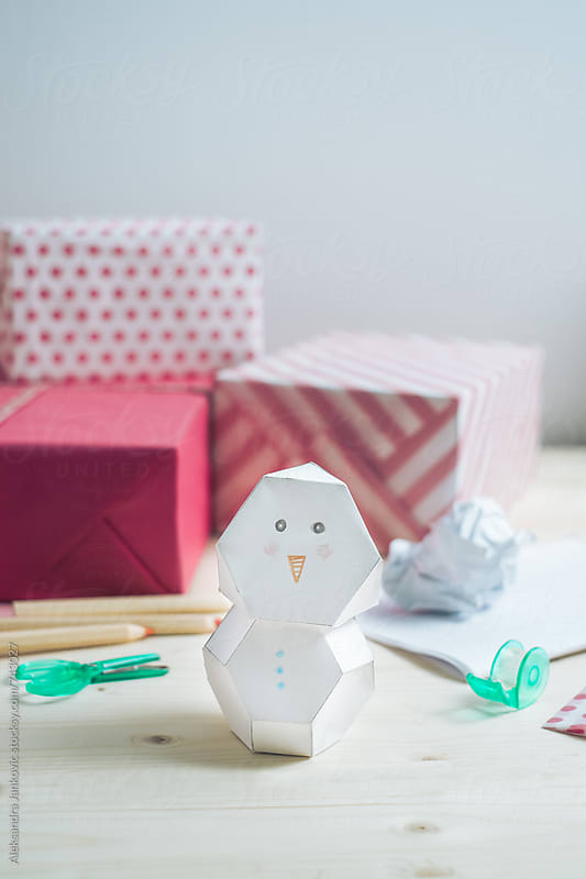 Paper Snowman on the Desk in Front of the Christmas Presents by Aleksandra Jankovic for Stocksy United