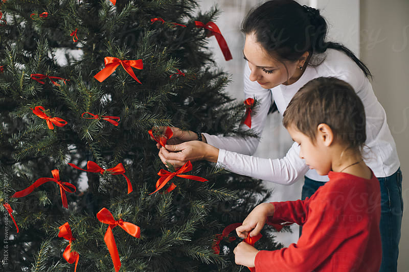 Mother and son decorating the fir-tree by T-REX & Flower for Stocksy United