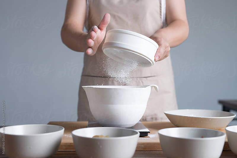 A young woman is making moon cake at home by MaaHoo Studio for Stocksy United
