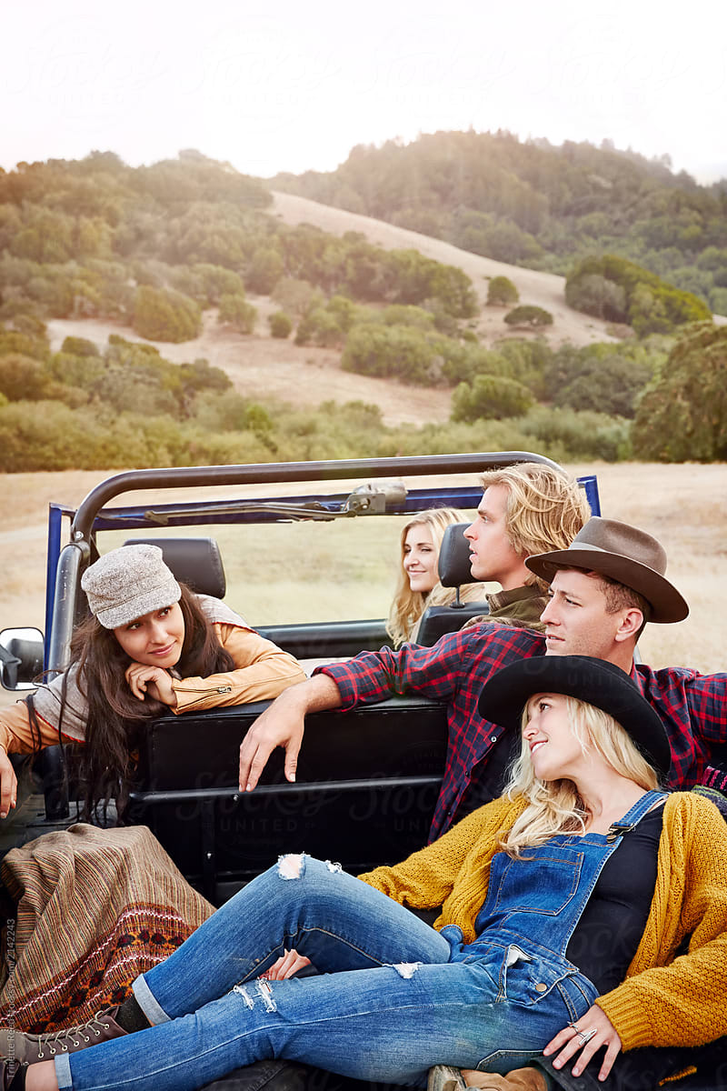 Portrait Of Group Of Friends In Nature While On Road Trip Relaxing By Trinette Reed Relaxation Road Trip Stocksy United