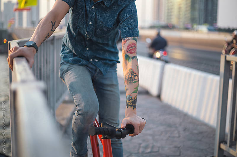 Closeup on man hands on bicycle by Jovo Jovanovic for Stocksy United