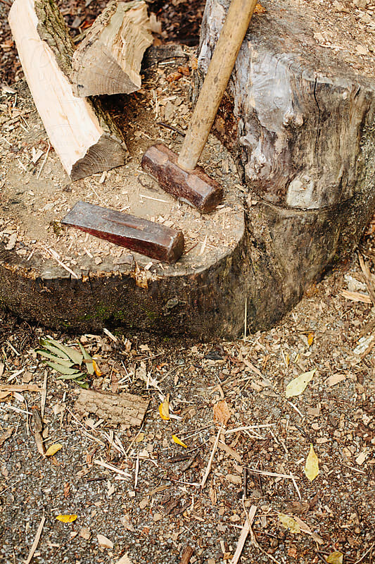 sledge and wedge for splitting logs by Brian Powell for Stocksy United