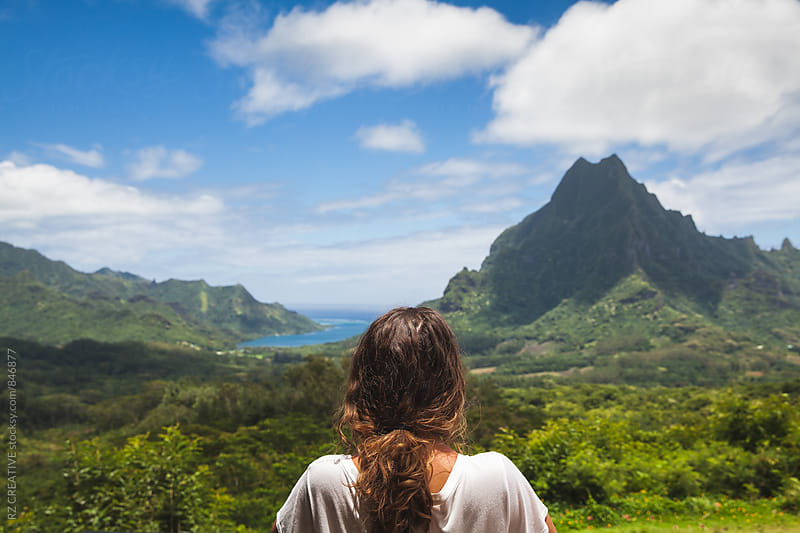 Woman looking out over a beautiful island landscape. by Robert Zaleski for Stocksy United