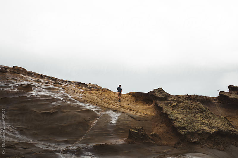 A man hiking the pasific coast by Kyle Meck for Stocksy United