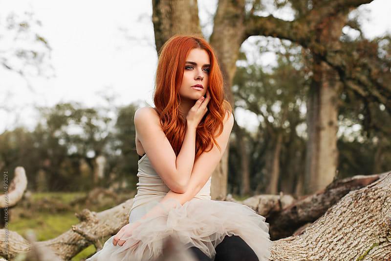 Redhead girl in a park by Ellie Baygulov for Stocksy United