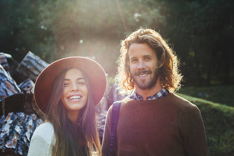 Portrait of a couple smiling in a rural landscape. by BONNINSTUDIO for Stocksy United
