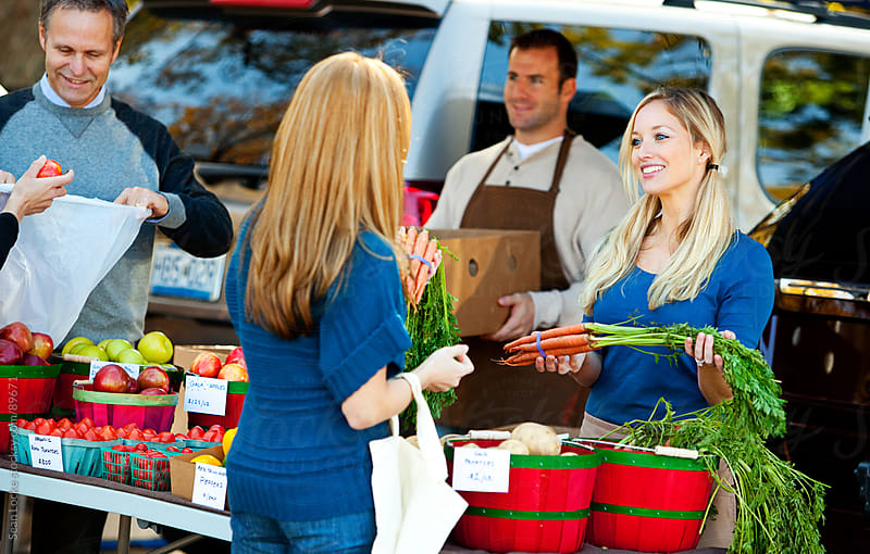 Farmer's Market: Woman Farmer Helps Customer by Sean Locke for Stocksy United