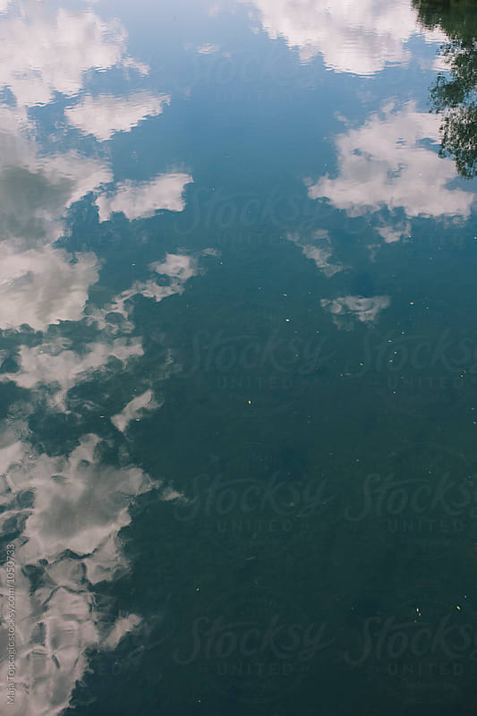 Waterscape on a cloudy day by Maja Topcagic for Stocksy United