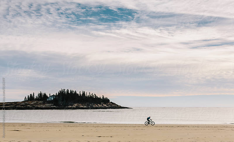 Lone Biker in Winter Coast of Maine by Raymond Forbes LLC for Stocksy United