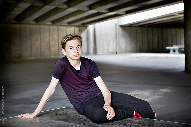 Portrait of a teenager by James Ross for Stocksy United
