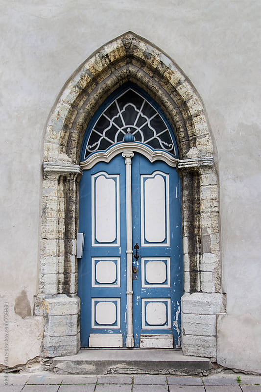 Old gothic blue door by Melanie Kintz for Stocksy United