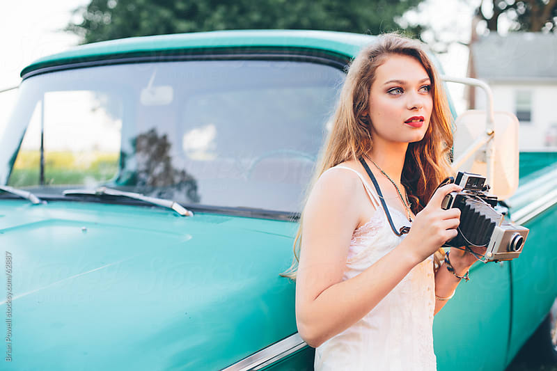 young woman with vintage camera by Brian Powell for Stocksy United