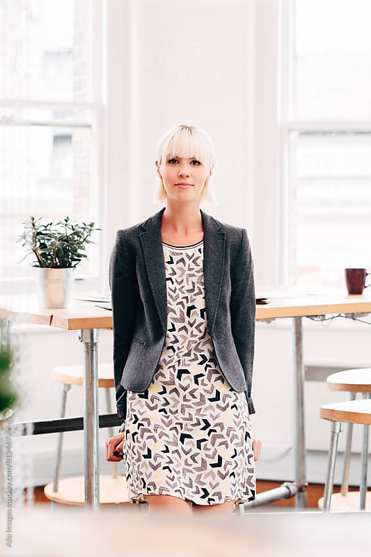 Portrait of businesswoman entrepreneur at work in stylish startup by Aila Images for Stocksy United