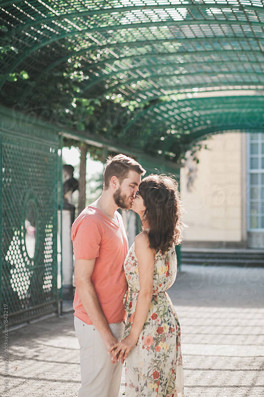 Couple holding hands and kissing by Irina Efremova for Stocksy United