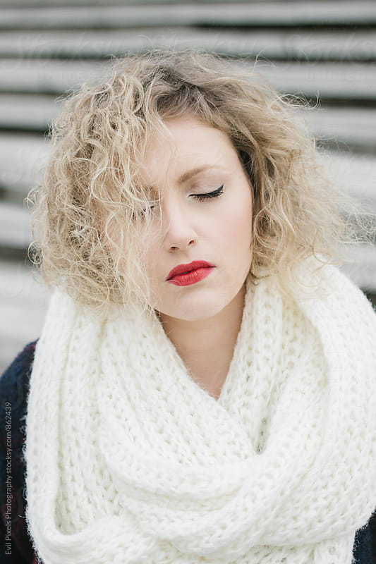 Portrait of a young beautiful curl model in winter clothes by Evil Pixels Photography for Stocksy United