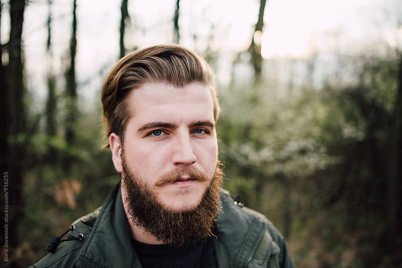 Portrait of stylish bearded man  by Boris Jovanovic for Stocksy United