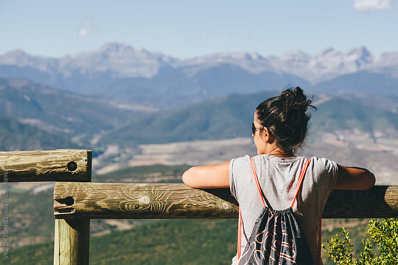 Young Woman Admiring the Pyrenees Mountain Range by VICTOR TORRES for Stocksy United
