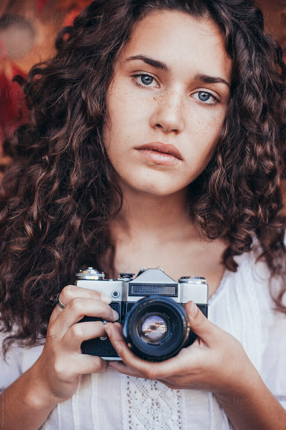 Beautiful Young Woman With Curly Hair Blue Eyes And Freckles By Maja Topcagic Stocksy United