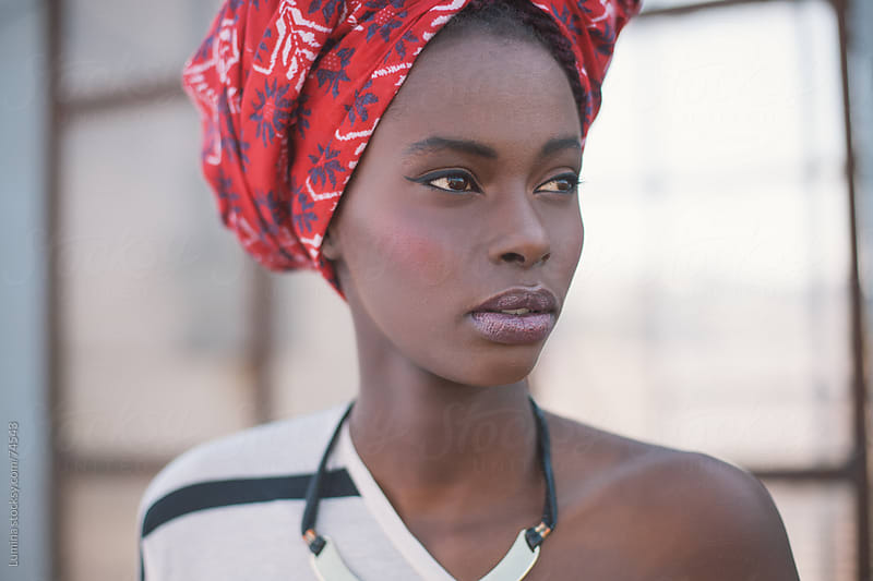 African Woman With a Turban by Lumina for Stocksy United