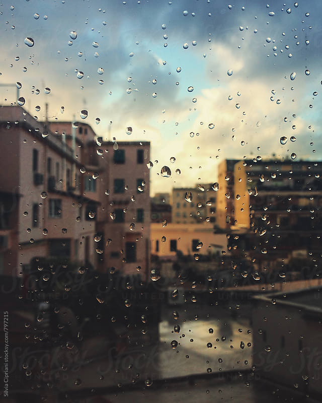 Raindrops on the window in a rainy day in Rome by Silvia Cipriani for Stocksy United