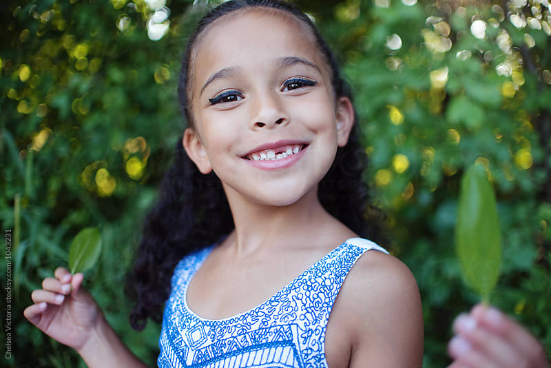 A beautiful young mixed race girl by Chelsea Victoria for Stocksy United