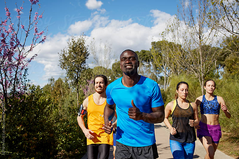Man Jogging With Friends On Sunny Day by ALTO IMAGES for Stocksy United