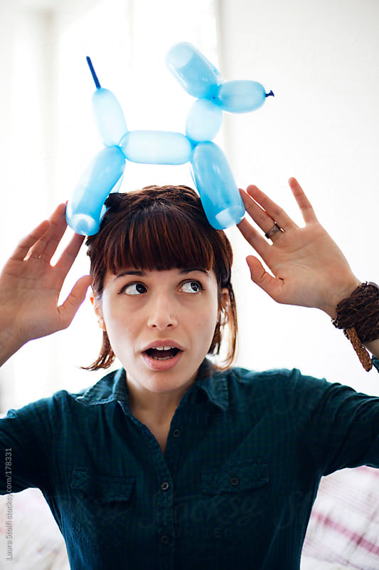 She has a dog on her head! by Laura Stolfi for Stocksy United