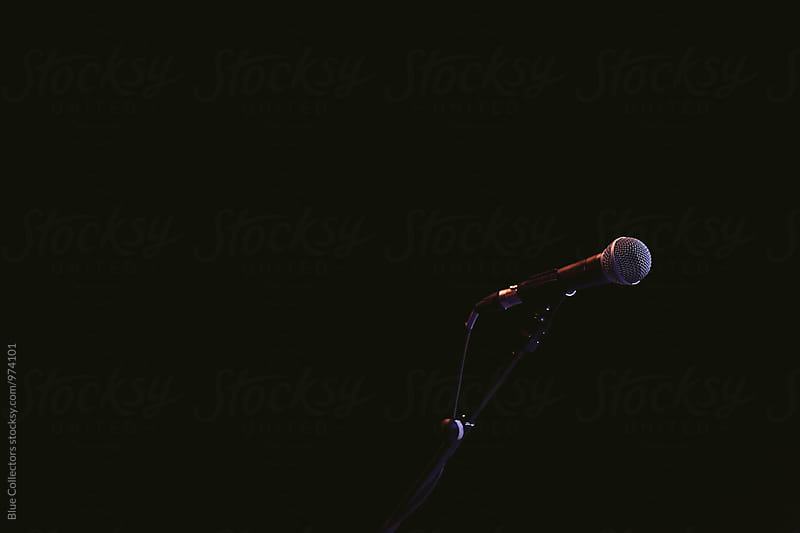 Microphone in a darkness by Jordi Rulló for Stocksy United
