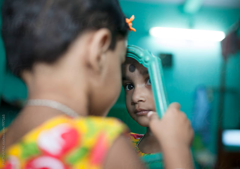A little girl  with reflection in the mirror by PARTHA PAL for Stocksy United