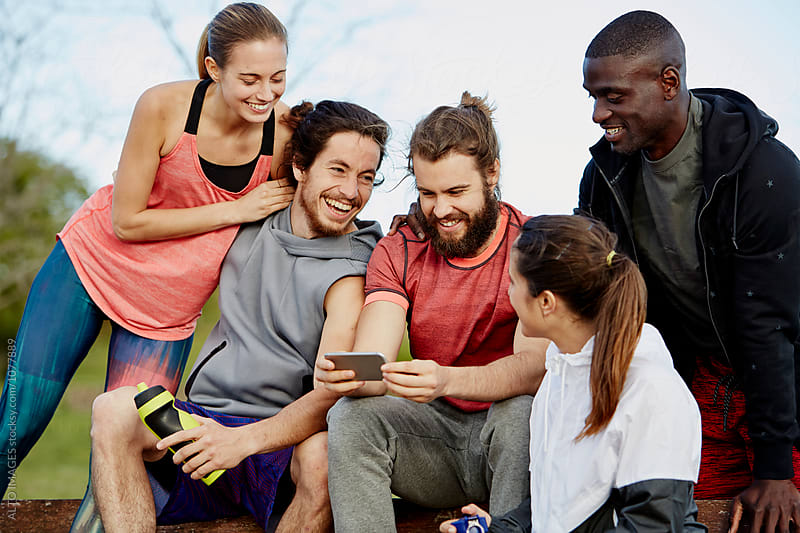 Friends Using Smartphone After Workout Outdoors by ALTO IMAGES for Stocksy United