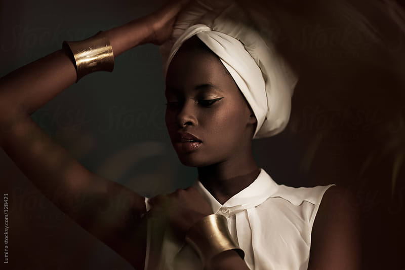 African Woman With a White Turban by Lumina for Stocksy United