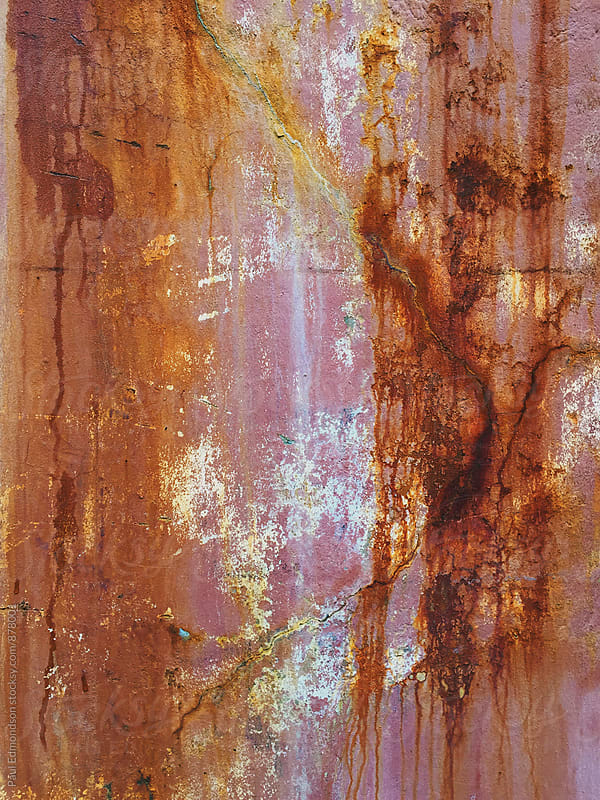 Close up of dripping paint and rust on building wall by Paul Edmondson for Stocksy United