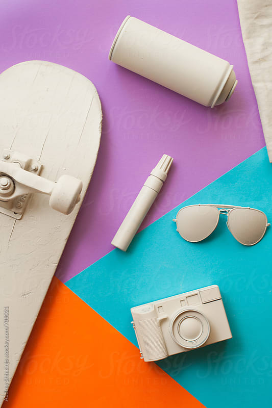 Various skateboarder/teenager objects  on blue orange and purple background. by Marko Milanovic for Stocksy United