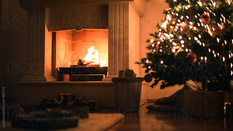 Christmas Tree by the Fireplace by Lumina for Stocksy United