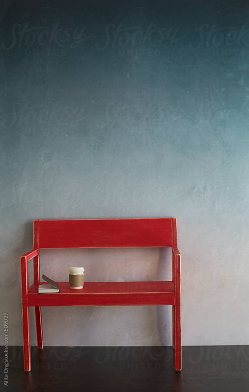 Red bench against ombre wall by Alita Ong for Stocksy United