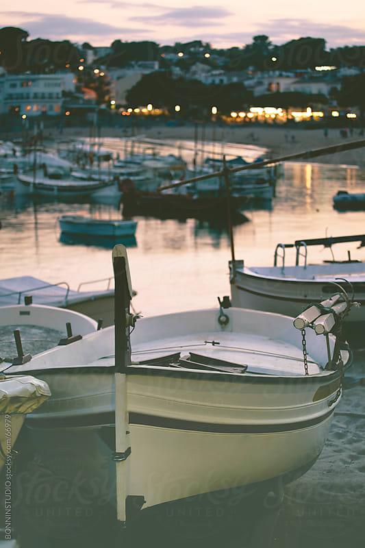 Boats on costa brava landscape. Pier of Llafranc, Catalunya. by BONNINSTUDIO for Stocksy United