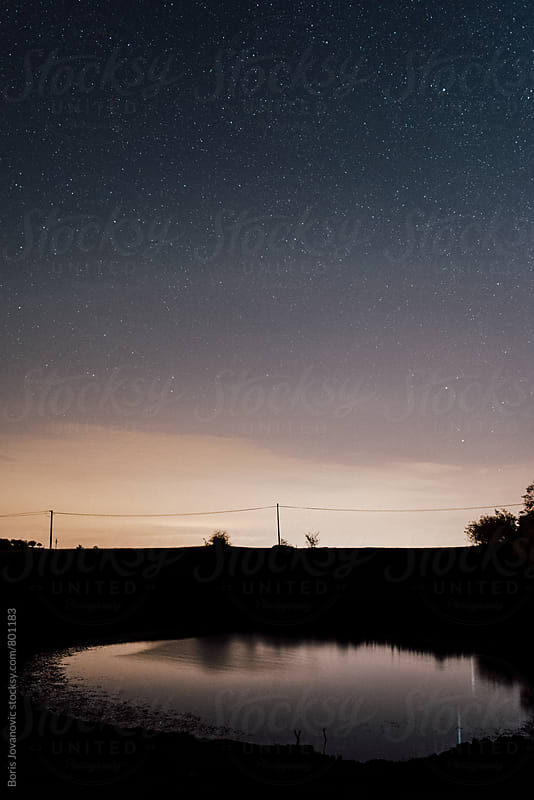 Beautiful night sky over the lake by Boris Jovanovic for Stocksy United