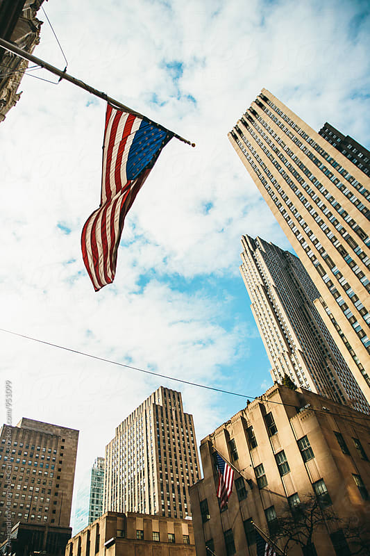 Waving American flag in New York street by Alejandro Moreno de Carlos for Stocksy United