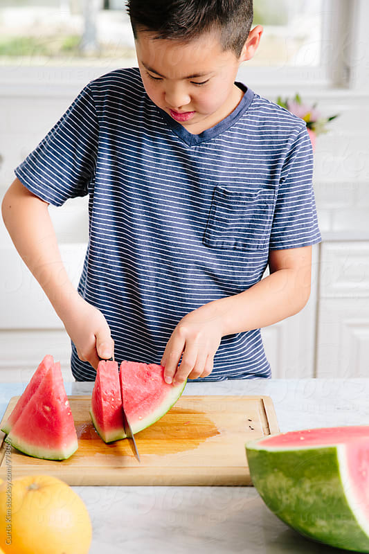 Kid preparing a healthy snack by Curtis Kim for Stocksy United
