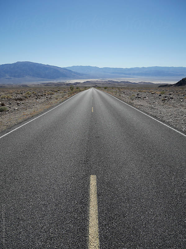 Endless road in Death Valley, USA. by rolfo for Stocksy United