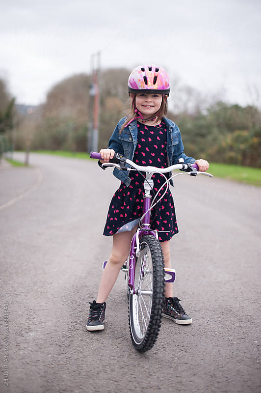 Smiling girl riding her new bike by CHRISTINA K for Stocksy United