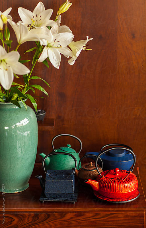 Colorful Teapots and Flowers on Wooden Table by Mosuno for Stocksy United