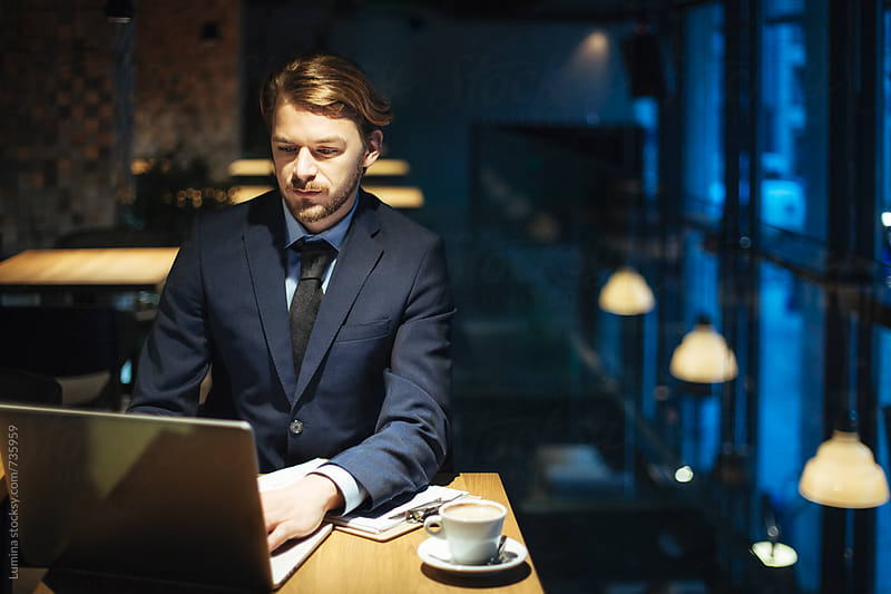 Young Businessman Working a a Cafe by Lumina for Stocksy United
