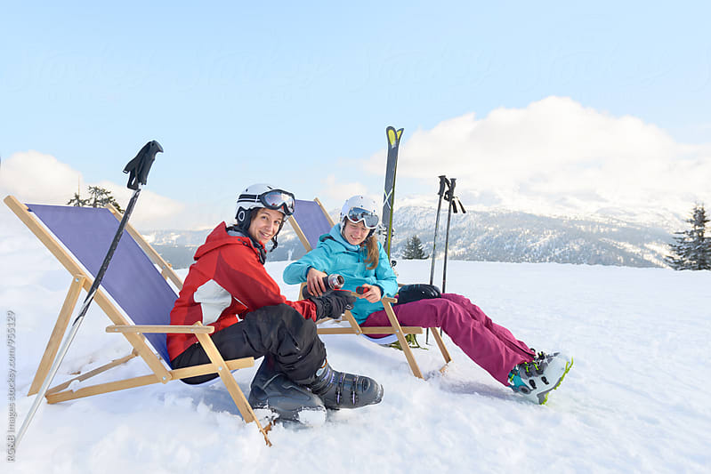 Friends taking a break and having te on the ski slope by RG&B Images for Stocksy United