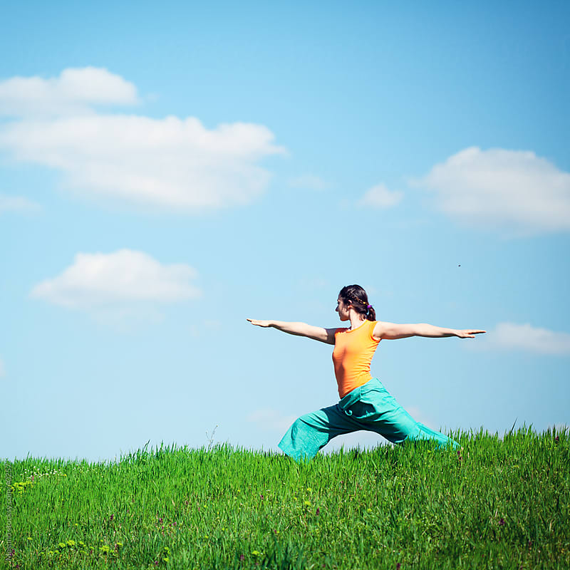 Young woman doing yoga in nature. by Mosuno for Stocksy United